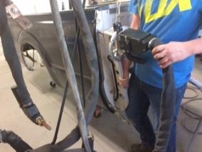 Tech using the resistance spot welder